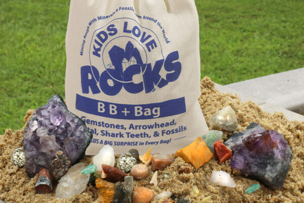 Big gemstone mining bag filled with sand and gems