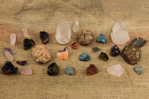 This photo shows a collection of gemstones and crystals from our Crystal bag