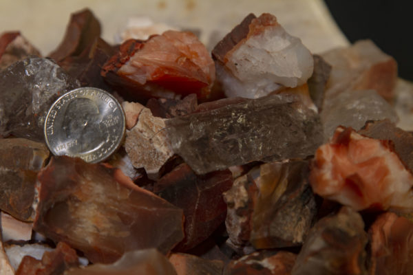 Pile of Carnelian Rough Gems 1 half pound with quarter for size