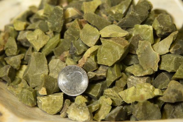 Pile of Grass Jasper Rough Gems 1 pound with quarter for size