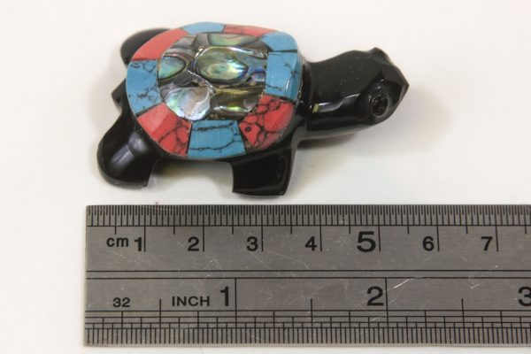 Obsidian Inlaid Turtle 2 inch next to ruler for size comparison