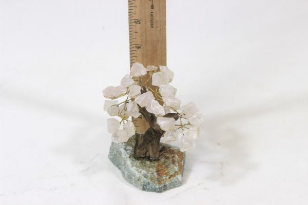 Small Rose Quartz Crystal Gemstone Tree next to ruler for size comparison