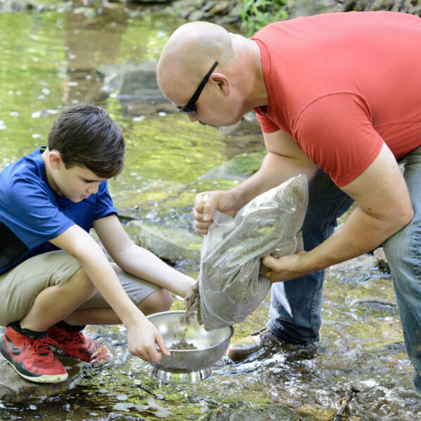 This is an image of a father and son sifting for gems with the Bonanza Box product