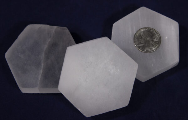Selenite Hexagon Charging Station with quarter to show size