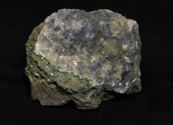 Amethyst Crystal Cluster embedded in green rock matrix