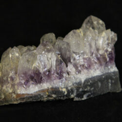 White and purple Amethyst Crystal Cluster embedded in green rock matrix