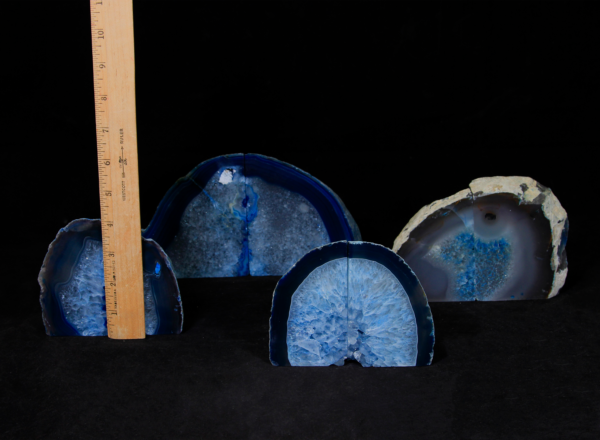 Four pairs of matching small blue Agate bookends next to ruler to show height