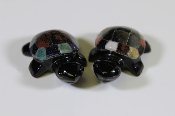Two Obsidian turtle figurines with assorted multi-colored shells