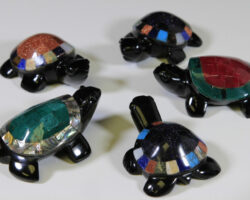 Five obsidian turtle figurines with assorted colored shells