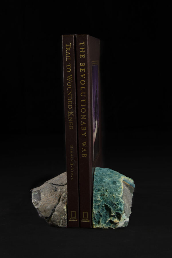 Two Colored Agate Gem Ends holding up books