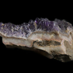 Purple colored Amethyst Crystal Cluster embedded in Pink rock matrix