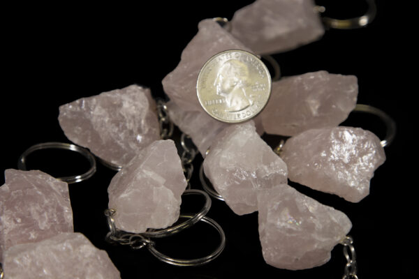 Rose colored Quartz Keychains with coin on top for size comparison