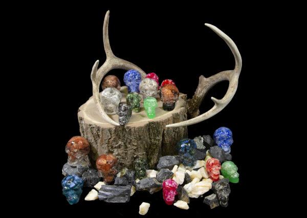 Assorted Halloween Bonanza Bucket Skulls and gemstones on wooden log