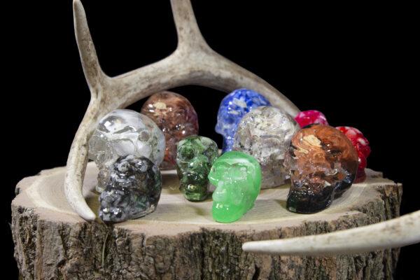Halloween Bonanza Bucket Skulls on wooden log next to antlers