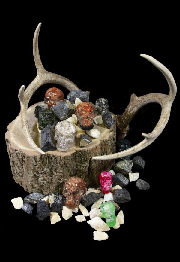 Halloween Bonanza Bucket skulls and gemstones on wooden log