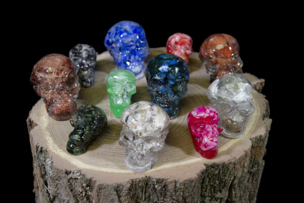 Halloween Bonanza Bucket colored skulls on top of wooden log